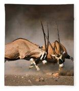 Gemsbok Fight Fleece Blanket by Johan Swanepoel