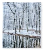 Tree Line Reflections In Lake During Winter Snow Storm Fleece Blanket