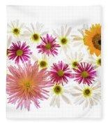 Variety Of Flowers Against White Fleece Blanket