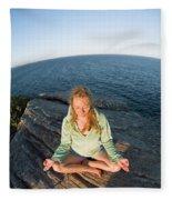 Yoga On Rocky Outcrop Above Ocean Fleece Blanket