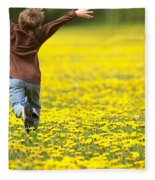Young Boy Running Through Field Of Fleece Blanket