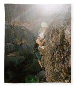 A Man Rock Climbing In Pinnacles Fleece Blanket
