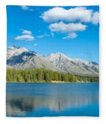 Lake With Mountains In The Background Fleece Blanket