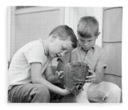 1970s Two Boys Seriously Inspecting New Fleece Blanket