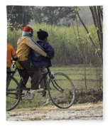 3 Young Children On A Cycle At The Side Of The Road Fleece Blanket