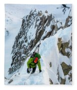 A Man Alpine Climbing A Ridgeline Fleece Blanket