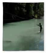 A Man Casts In A River Wearing Waders Fleece Blanket