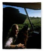 A Woman Sits In Her Safari Jeep Fleece Blanket