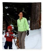 A Young Boy And Mother Sledding Fleece Blanket