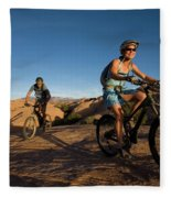 Couple Mountain Biking, Moab, Utah Fleece Blanket