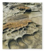 Eroded Sandstone Cliff Along The Ocean Fleece Blanket