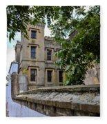 Peek Through The Tree's Of Old City Jail Fleece Blanket
