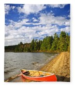 Red Canoe On Lake Shore Fleece Blanket by Elena Elisseeva