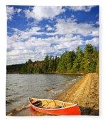 Red Canoe On Lake Shore Fleece Blanket