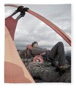 A Man Setting Up A Tent Fleece Blanket