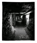 A Tunnel In The Catacombs Of Paris France Fleece Blanket
