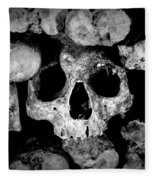 Altered Image Of Skulls And Bones In The Catacombs Of Paris France Fleece Blanket