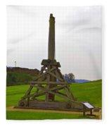 Replica Of Wooden Trebuchet And The Ruins Of The Urquhart Castle Fleece Blanket