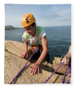 Rock Climbing On Oceanside Cliffs Fleece Blanket