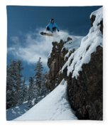 A Male Snowboarder Wearing A Bright Fleece Blanket