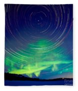 Star Trails And Northern Lights In Night Sky Fleece Blanket