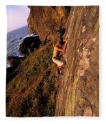 A Man Is Bouldering Near The Ocean Fleece Blanket