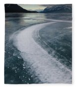 Ice Pattern On Frozen Abraham Lake Fleece Blanket