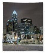 Charlotte Queen City Skyline Near Romare Bearden Park In Winter Snow Fleece Blanket