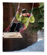 A Boy Plays Outside In Lake Tahoe Fleece Blanket