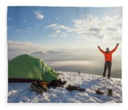 A Camper Lifts His Hand In The Air Fleece Blanket