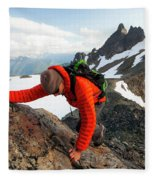 A Climber Scrambles Up A Rocky Mountain Fleece Blanket