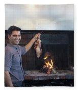 A Cook Hangs A Turkey Over Fire Pit Fleece Blanket