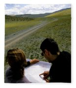 A Couple Hiking Across The Atlai Fleece Blanket