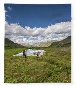 A Couple Hiking Through A Field Fleece Blanket