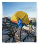 A Couple Of Backpackers Carry Fleece Blanket