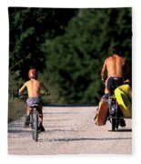 A Father And Son Ride Their Bikes To Go Fleece Blanket
