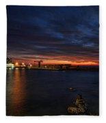 a flaming sunset at Tel Aviv port Fleece Blanket