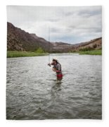 A Fly Fisherman Mends While Fishing Fleece Blanket