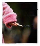 A Hand Holding A Cigarette Fleece Blanket