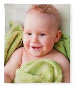 A Happy Baby Lying On Bed In Green Towel Fleece Blanket