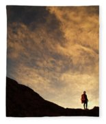 A Hiker Standing On A Ridge At Sun Rise Fleece Blanket