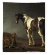 A Horse With A Saddle Beside It Fleece Blanket