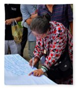 A Lady Signs Petition At May Day Rally Singapore Fleece Blanket