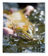 A Large Cutthroat Being Released Fleece Blanket
