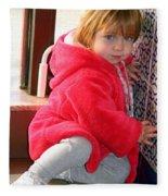 A Little Girl In Red Fleece Blanket