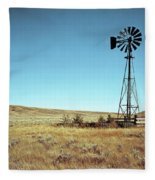 A Lone Windmill Stands On The Canadian Fleece Blanket