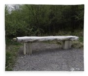 A Long Stone Section Over Wooden Stumps Forming A Rough Sitting Area Fleece Blanket
