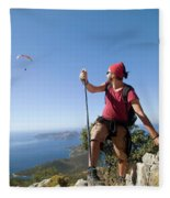 A Male Climber Looking At Paragliding Fleece Blanket
