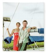 A Man And A Woman Embrace In Sailboat Fleece Blanket
