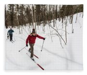 A Man And Woman Cross Country Skiing Fleece Blanket